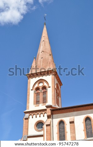 Renovated church tower in St Lys, France - stock photo