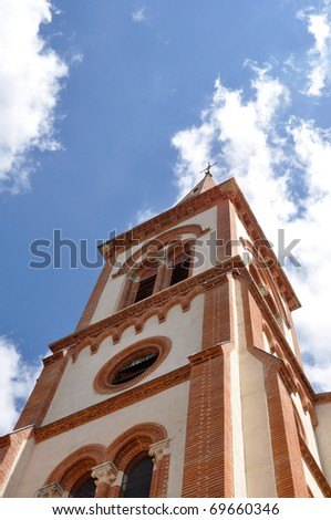 Renovated church tower with a brick architecture - stock photo