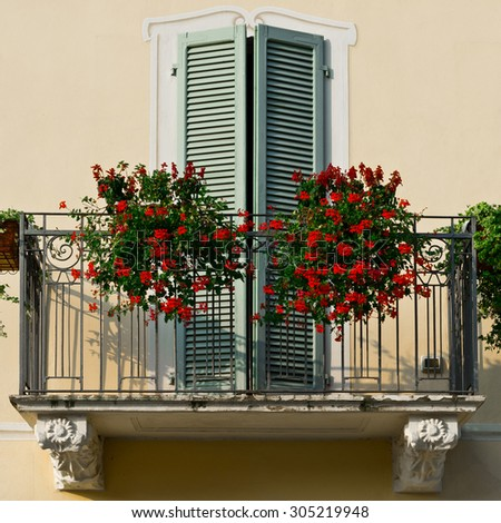 Renovated Facade of the Old Italian House with Balcony Decorated with Fresh Flowers, Instagram Effect