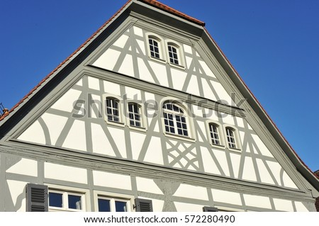 Renovated Half Timber House Front With Gables, Covered With Shale And Tiled  Roof