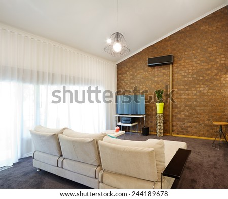 Renovated retro 70s architectural apartment with angled roofline - stock photo