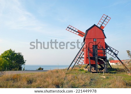 renovated windmill with trees Sweden - stock photo