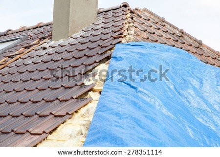 renovation of a brick tiled roof - stock photo