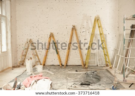 Renovation site with ladders of different height. - stock photo