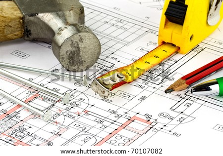 Renovations plan of the apartment with hammer and nails - stock photo