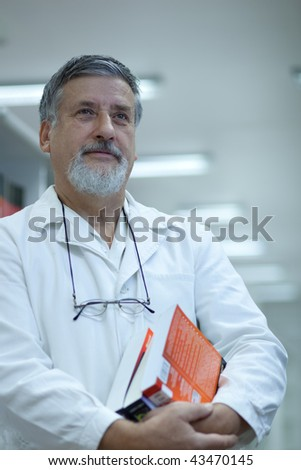 Renowned scientist/doctor in a research center/hospital looking confident