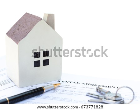 rental agreement contact with an architectural model and a calculator and pen and keys