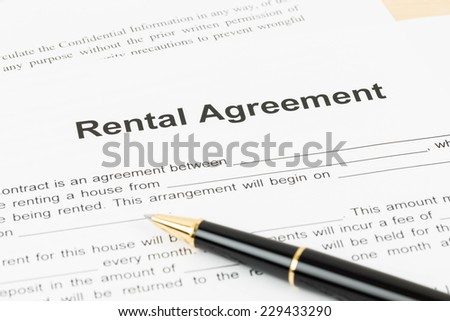 Rental agreement document with pen - stock photo