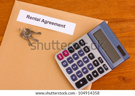 Rental agreement on wooden background close-up - stock photo