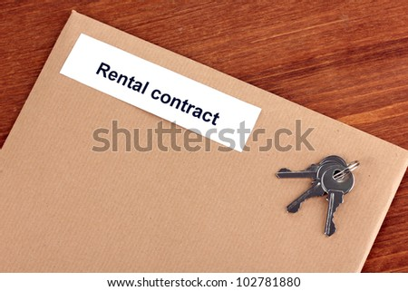 Rental contract on wooden background close-up - stock photo