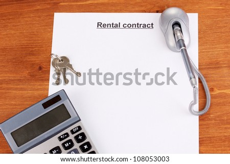 Rental contract on wooden background close-up
