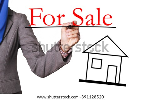 Rental Income - Real Estate Concept - House with text and Businesswoman hand with pen - stock photo