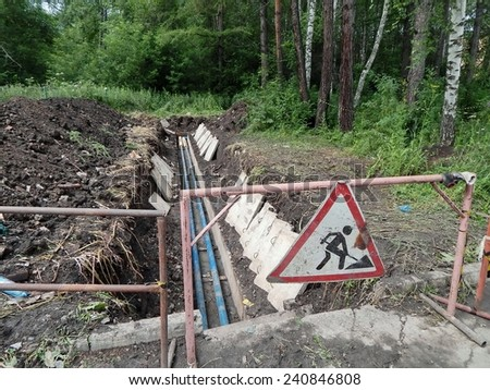 Repair and construction work, repair of communications, to lay new pipes. - stock photo