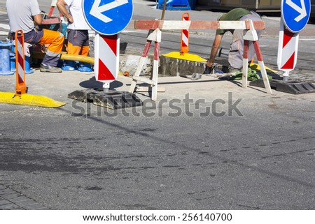 Repair and replacement of water pipes in the street - stock photo