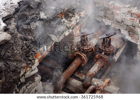 Repair broken old rusty pipes of the heating system in water - stock photo
