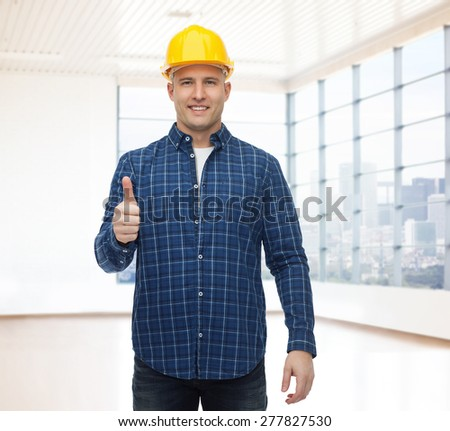 repair, construction, building, people and maintenance concept - smiling male builder or manual worker in helmet showing thumbs up - stock photo