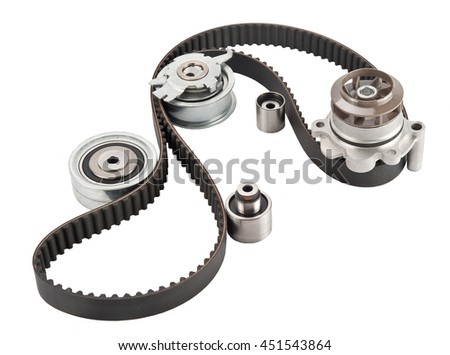 Repair kit: Timing belt with rollers, Tensioner pulley, Deflection pulley, Two rollers, Water pump and bolts isolated on white background. Automobile spare part