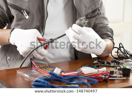 repair man, engineer fixing computer wire part on work table