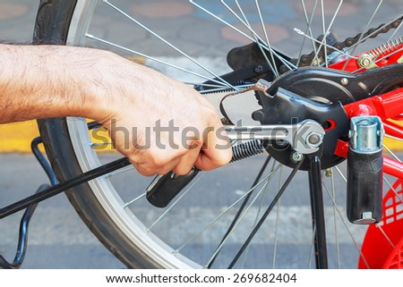 repair of a bicycle with a wrench - stock photo