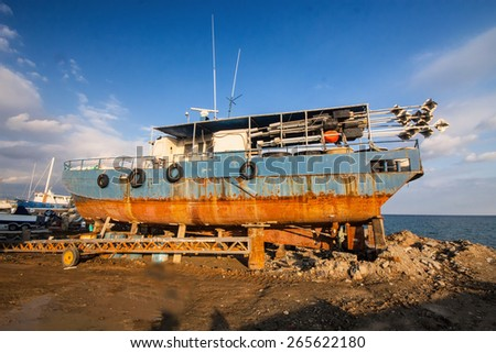 repair of a large ship in dry dock, Cyprus - stock photo