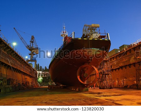 Repair of a small ship to dock. - stock photo