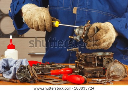 Repair of details car engine in the workshop - stock photo