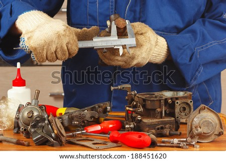 Repair of old parts car engine in the workshop - stock photo