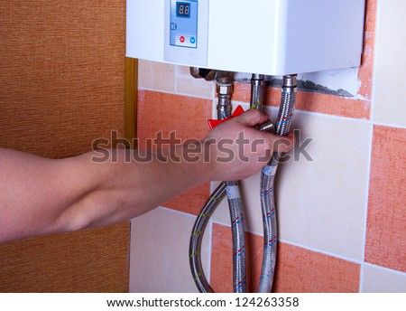 repair of the gas water heater - stock photo