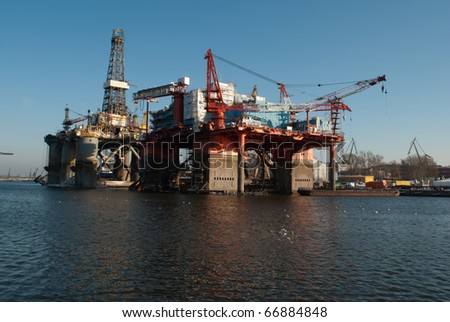 Repair of the oil rig in the shipyard - stock photo