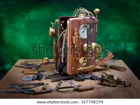 Repair phone on a wooden table. Steampunk style. - stock photo