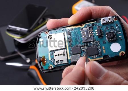 Repair phones and smartphones - stock photo