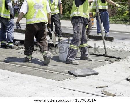 Repair to streetcar track in urban setting - stock photo