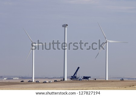 repair work on the blades of a windmill for electric power production - stock photo