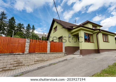 repaired rural house, fixed facade, insulation and painted to green  color - stock photo