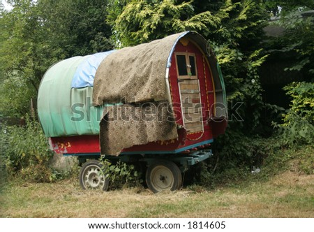 Repaired travellers caravan which was a home to a gypsy and used to be pulled by horses to travel around the countryside but sadly it is not in use anymore - stock photo