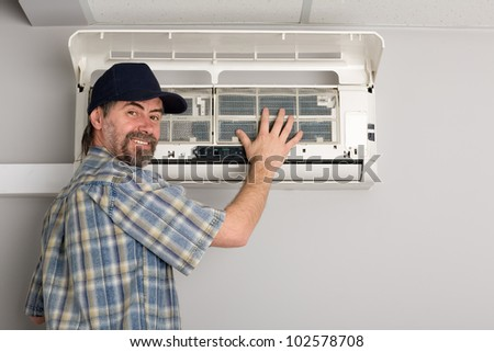 Repairer conducts adjustment of the indoor unit air conditioner.