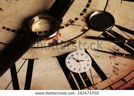repairing an old and broken clock - stock photo