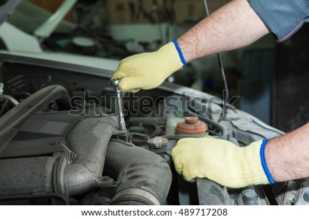Repairing automotive body closeup photo