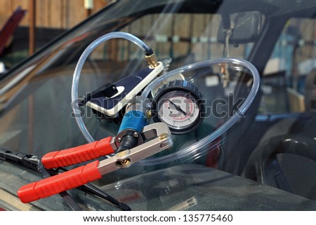 Repairing equipment for fixing of damaged windshield, vacuum pump - stock photo