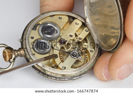 repairing old clock work,old mechanical watch - stock photo
