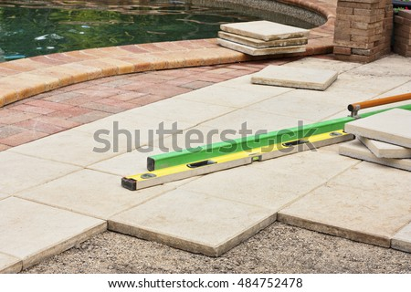 repairing the pavers around the pool area