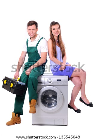 repairman and young girl sitting on the washing machine