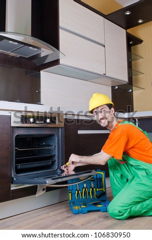 Repairman assembling the furniture at kitchen