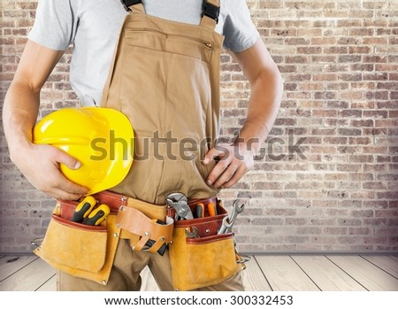 Repairman, closeup, clothing.