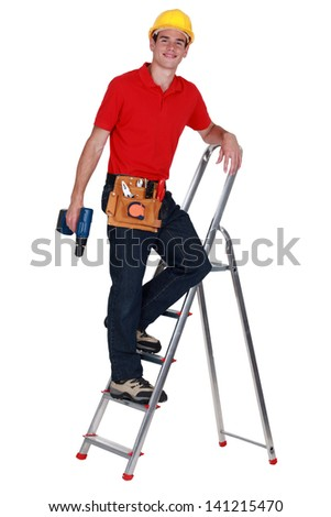 Repairman on a ladder - stock photo