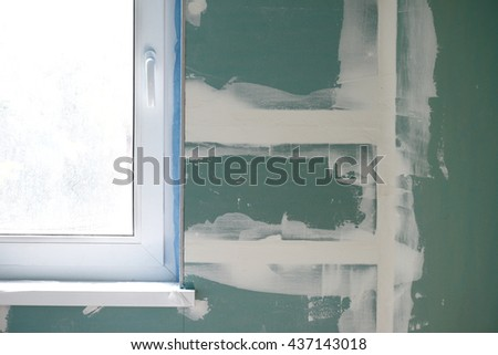 repairs in a new apartment, window and plasterboard or gypsum cardboard, plaster on the wall. - stock photo