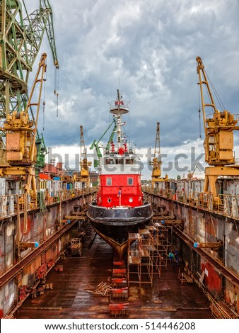 Reparation Fire-boat in large floating dry dock.