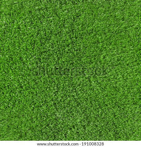 repeatable synthetic grass texture background with highlights - stock photo
