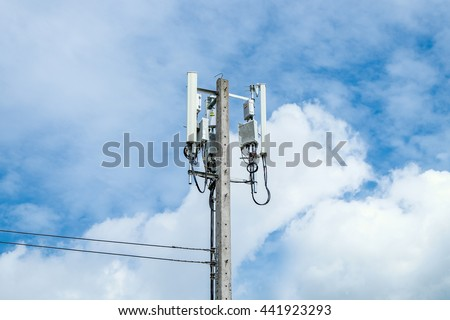 repeater telecommunication tower on electric pole with blue sky