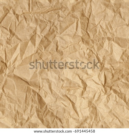Repeating crumpled brown parcel packing paper background texture. Tileable wallpaper repeats left, right, up and down.
